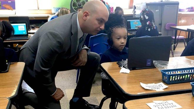 Nikolai Vitti, superintendent of the Detroit Public Schools Community District, talks to Amiyah Johnson during Dionne Garrett's kindergarten class at Cooke STEM Academy in Detroit on Tuesday, Feb. 5, 2018.