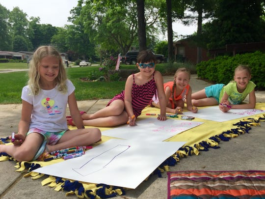 Girls from Sarah's Brownie troop spent an afternoon at her house helping to make signs for the Kids Fun Run for Paws.