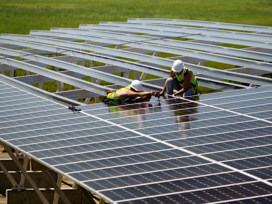 Crews installed solar panels above newly created parking