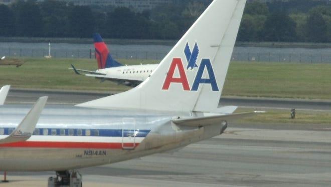 This file photo shows Delta Air Lines and American Airlines aircraft at Washington's Reagan National Airport.