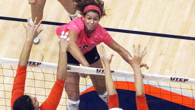 UTEP setter Lindey Larson, 16, goes up for a kill against UT-San Antonio last Sunday in Memorial Gym.