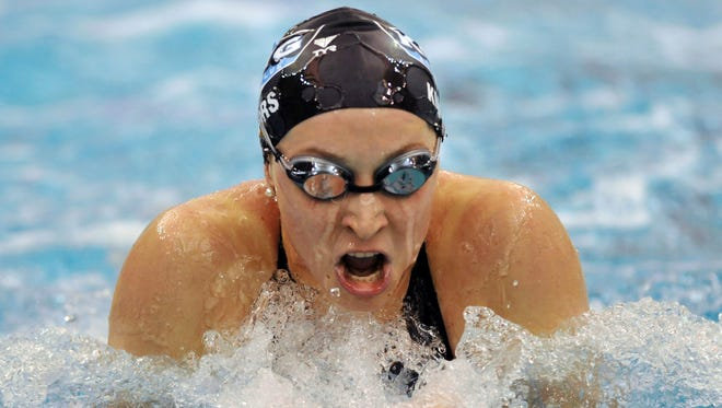 In this Dec. 6, 2008, file photo, Ariana Kukors swims to win the women's 200-yard breaststroke finals during the 2008 USA Swimming Short Course National Championships at the Georgia Tech Aquatic Center in Atlanta. Olympic swimmer Kukors Smith sued USA Swimming on May 21, 2018, alleging the sport's national governing body knew her former coach sexually abused her as a minor and covered it up.