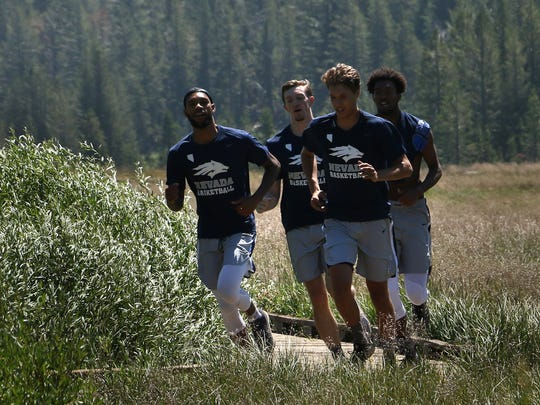 "Members of the Nevada men's basketball team participate in their annual ""Tahoe Run"" in Tahoe Meadows on Friday."