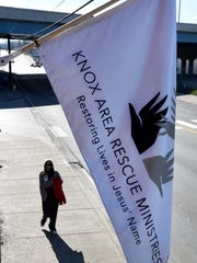 """Knox Area Rescue Ministries (KARM) hang its symbolic """"white flag"""" outside its Broadway headquarters when severe weather hits. The flag signifies the shelter's open door policy when temperatures reach extreme heat or drop below freezing. (MICHAEL PATRICK/NEWS SENTINEL)"""