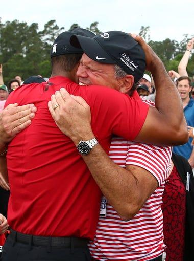 Apr 14, 2019; Augusta, GA, USA; Tiger Woods hugs Glenn Greenspan after winning The Masters golf tournament at Augusta National Golf Club.