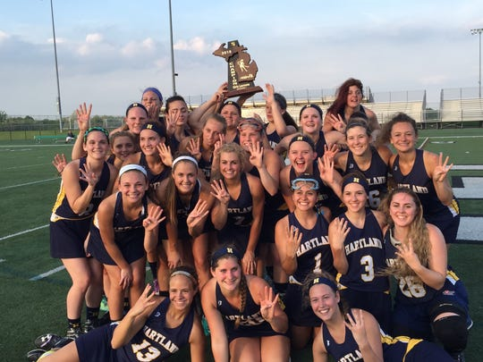 Hartland's girls lacrosse team poses with the regional trophy after winning its fourth consecutive title on Friday at Lake Orion. The Eagles rolled past the Dragons, 17-7, and will take on Rockford on Wednesday at Brighton in the Division 1 semifinals.