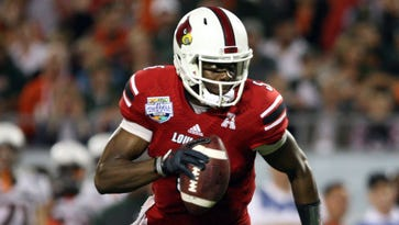Minnesota Vikings quarterback Teddy Bridgewater, shown during his playing days under Charlie Strong at Louisville, has full faith in what Strong is doing at Texas.