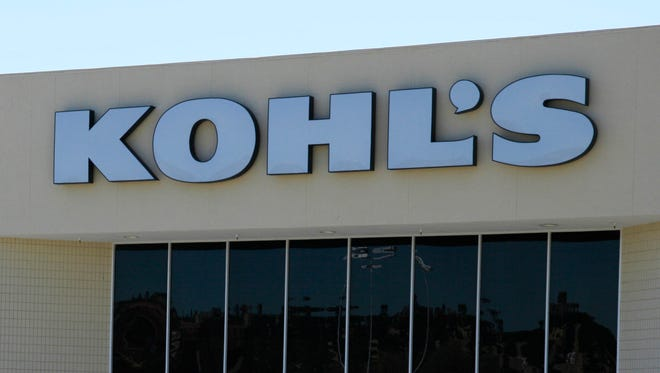 In this Aug. 8, 2011, file photo, shoppers enter and exit a Kohl's store in San Rafael, Calif.