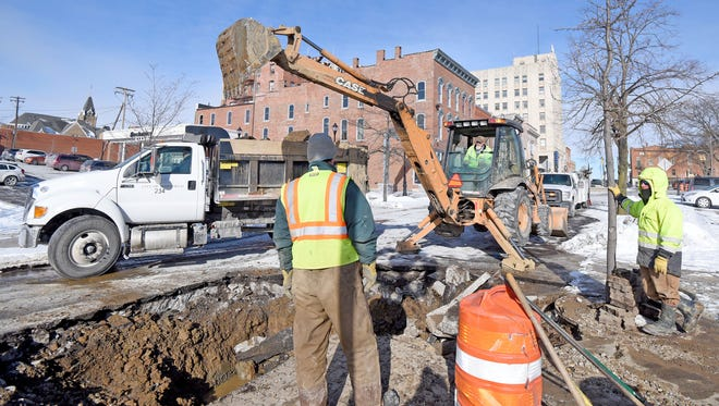 A crew from the City of Mansfield opens a portion of Main Street between Park Avenue and Second Street after a water main broke earlier Friday morning. A new digital mapping system is designed to help the city respond to such problems more efficiently.