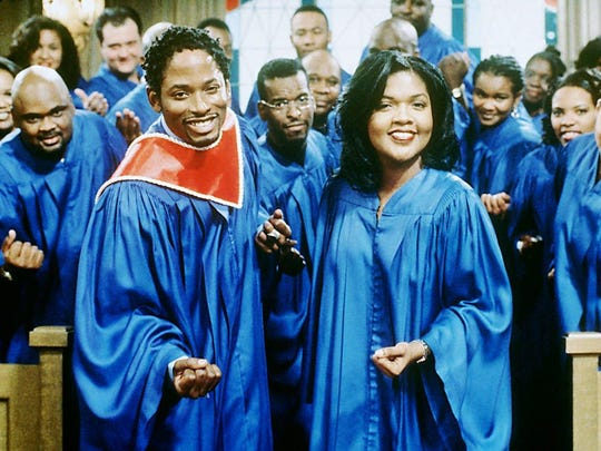 "Kyle (T.C. Carson, front, left) is forced to sing the church solo with help from Latrice (Cece Winans, front right) after Regine (Kim Fields Freeman, not pictured) gets laryngitis and is unable to perform on the ""Living Single"" episode ""Oh, Solo Mio."""