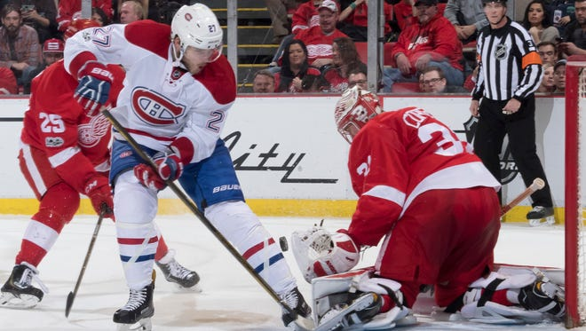 Montreal center Alex Galchenyuk tries to get the puck past Detroit goalie Jared Coreau in the second period.
