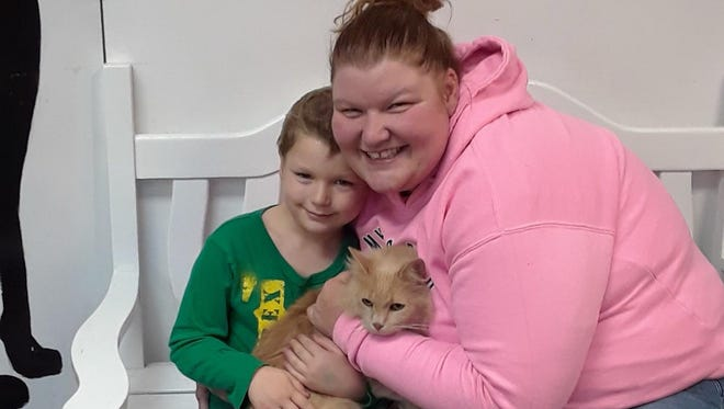 Nakota Harris with her son and Binx the cat after the family was reunited with their pet.