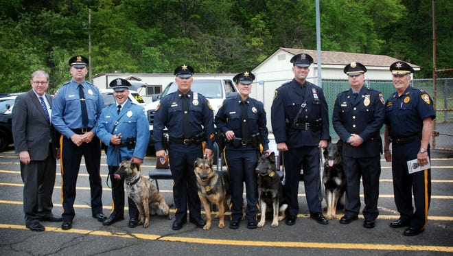 Union County Sheriff Joseph Cryan congratulates Patrolman Christopher Laver and K9 Jada of the Hackettstown Police Department, Patrolman Matthew Casterline and K9 Chase of the Hillside Police Department, Officer Albert Bauer and K9 Diesel and Officer Shannon Dinella and K9 Basilone from the Somerset County Sheriff's Office on graduating from the Union County's Sheriff's Office K9 Training Academy during the graduation ceremony for Class 17-01 in Summit. They were joined by Somerset County Sheriff Frank Provenzano, Hackettstown Police Chief James Macaulay and Sgt. Brian Howarth of the Union County Sheriff's K-9 Unit.