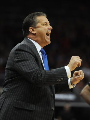 Kentucky head coach John Calipari yells instruction to his team as the Cats take on UofL on Saturday at the KFC YUM! Center. (By David Lee Hartlage, Special to the C-J) Dec. 27, 2014.