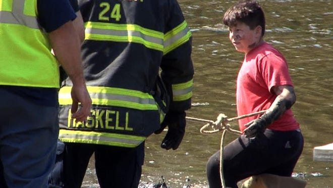 Herbertsville firefighters used a ladder to help Jamison Thomas, 15, get free from the mud near Riverside Drive North in Brick Friday evening, May 20, 2016.