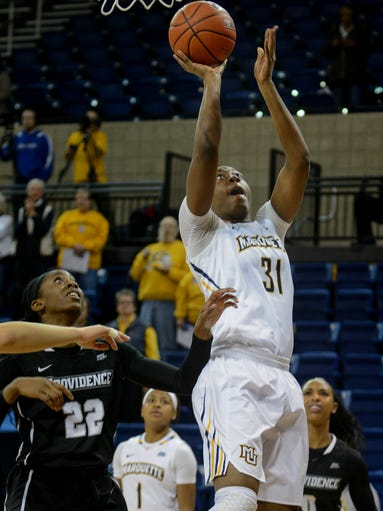 Marquette center Chantelle Valentine goes to the basket