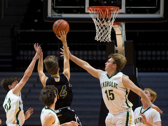 Knoxville Catholic's Sean Purcell (23) and Reece Harpst