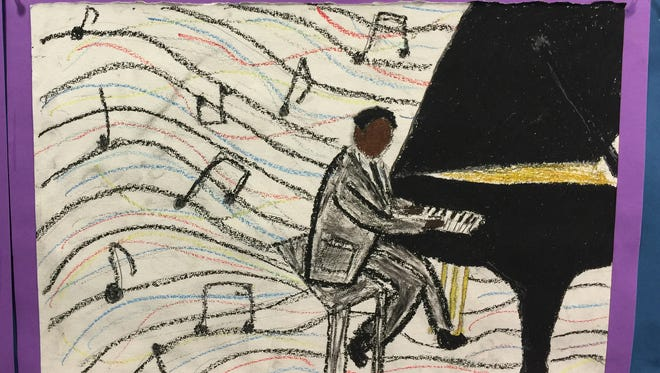 Dutchess Day School eighth-grader Calvin Walker depicts jazz musician Jelly Roll Morton, the first jazz artist to write down his compositions.