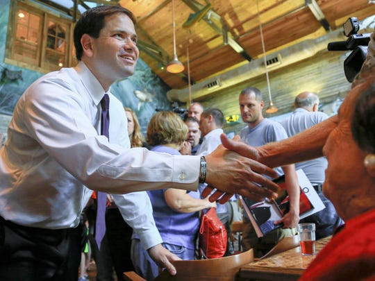 Republican presidential candidate Sen. Marco Rubio, R-Fla., greets members of the audience following a campaign stop in Council Bluffs on Friday.