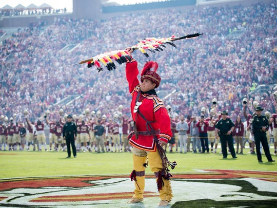 Seminole Tribe headdresses aren't the long, extravagant ones typically seen at games, but rather more turban-style, as seen on Seminole Tribe member Kyle Doney.
