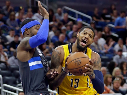 FILE - In this April 8, 2017, file photo, Indiana Pacers' Paul George (13) tries to get position to shoot against Orlando Magic's Terrence Ross during an NBA basketball game in Orlando, Fla. Two people with knowledge of the details say the Pacers have agreed to trade George to the Oklahoma City Thunder for Victor Oladipo and Domantas Sabonis in a stunning deal that gives MVP Russell Westbrook a new running mate. (AP Photo/John Raoux, File)