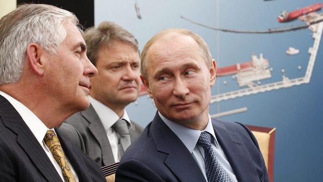 Russian President Vladimir Putin and Rex Tillerson in 2012.
