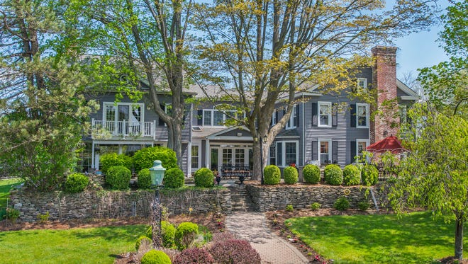 Originally built in 1810 but renovated and expanded, this historic.five-bedroom home sits on 89 acres in Hampton Township.