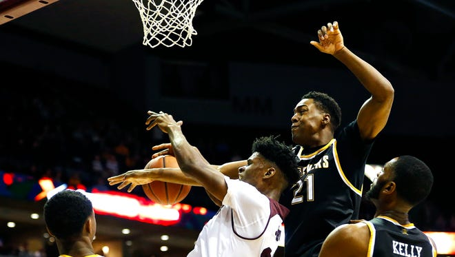 Missouri State forward Alize Johnson has his shot blocked by Wichita State forward Darral Willis Jr. during the first half.