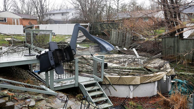 Sherry Wallace's back yard was destroyed after storms hit Anderson Township Wednesday March 1, 2017. Wallace said her house on Azure Court didn't have any damage.