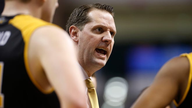 Northern Kentucky's head coach John Brannen talks with his team during a time out in first round of the NCAA Men's Basketball Championship in Indianapolis on Friday March 17, 2017.