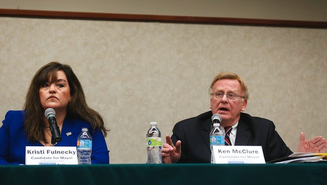 Mayoral candidates Kristi Fulnecky, left, and Ken McClure during the News-Leader's Hometown Election forum held at the Library Center in Springfield on Thursday. The forum featured candidates for citywide races in this April's election.