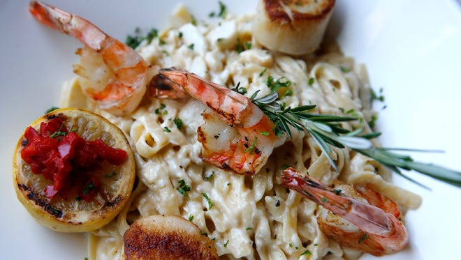 Seafood fettuccine, with scallops, shrimp, crab and roasted shallots by Fire Restaurant, 50 E. RiverCenter Blvd in Covington.