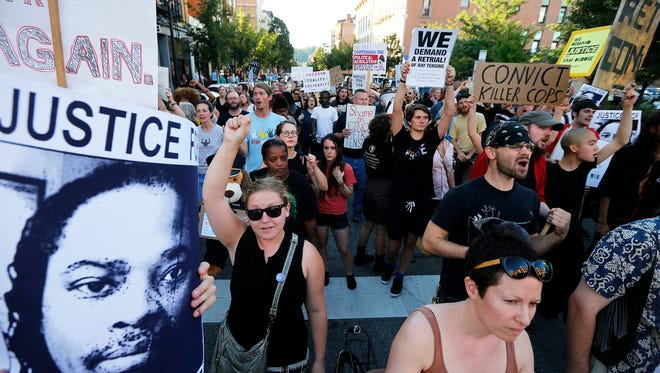 "Demonstrators fill Vine Street in Over-the-Rhine during ""Rally and Street Action: Demand a Retrial"" Justice for Sam DuBose sponsored by Black Lives Matter: Cincinnati Saturday, July 8, 2017. The rally was in protest of the second mistrial of Ray Tensing. Tensing, a former University of Cincinnati police officer was charged with murder and voluntary manslaughter in the shooting death of Sam DuBose during a traffic stop in July 2015."
