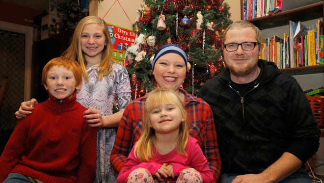 Sheila Barbre, center, her husband Jake, right, and their three children, Alacia, 12, William,10 and Eleanor, 4, at their Hamilton home. Sheila was recently diagnosed with breast cancer and is currently receiving chemotherapy. They are desperate to replace their old vehicle that has no functioning air or heat, among other problems. Photo shot Thursday December 7, 2017.