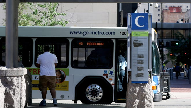 Passengers load Metro buses at Government Square on June 14, 2018. The bus stop in question is at Fifth and Main streets.