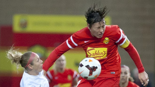 File: Portland's Nikki Marshall, left, and Western New York's Abby Wambach fight for the ball.