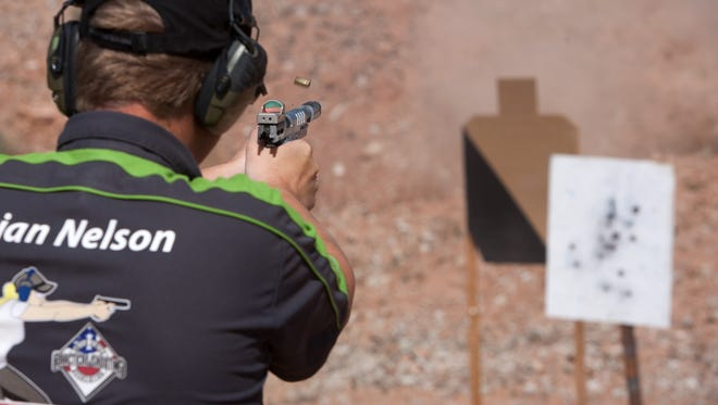 Brian Nelson shoots at targets on the practical shooting range at the Southern Utah Shooting Sports Park Wednesday, April 18, 2012 in Hurricane.