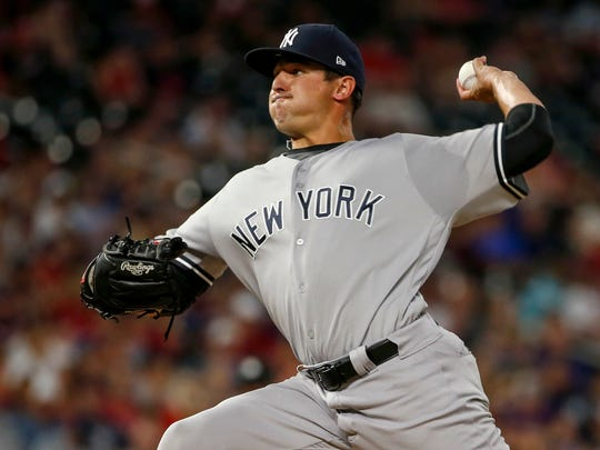 New York Yankees relief pitcher Caleb Smith throws