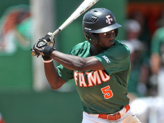 FAMU's Willis McDaniel eyes a pitch against NCA&T at
