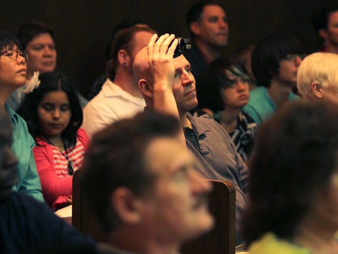 Scenes from the United States Courthouse in Springfield Friday, June 6, 2014, where 43 people became American citizens.