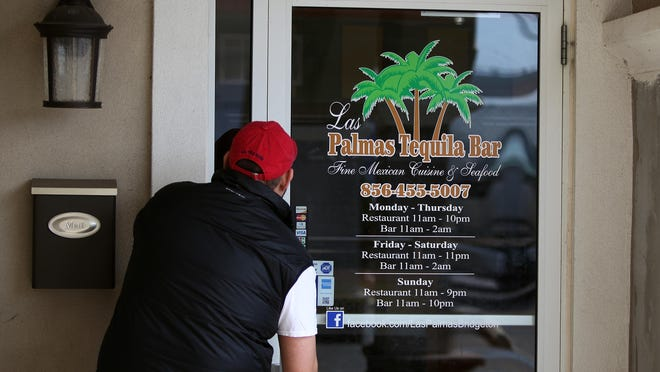 Police said two men were shot, one fatally, after a Sunday morning bar fight at Las Palmas Tequila Bar in Bridgeton, which is pictured above as an employee opens the door for service Monday. Staff Photo/Sean M. Fitzgerald