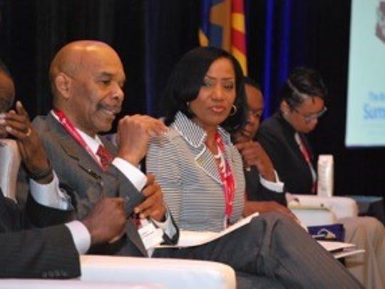 "Denver Police Chief Robert White speaks at The Bridge Summit at the Palomar Hotel in Phoenix while Atlanta Deputy Chief Cerelyn ""CJ"" Davis looks on."