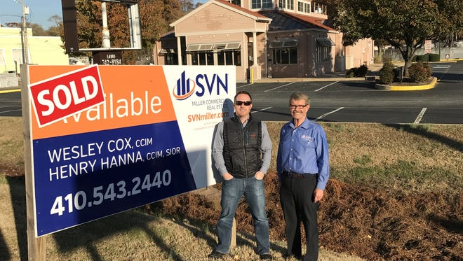 Commercial real estate advisors Wesley Cox, left, and Henry Hanna pose in front of the site of a new Krispy Kreme shop in Salisbury that is set to open in April.