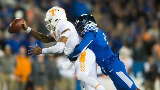Tennessee quarterback Jarrett Guarantano (2) is sacked by Kentucky cornerback Derrick Baity (8) during the Tennessee vs. Kentucky game at Kroger Field in Lexington, Kentucky Saturday, Oct. 28, 2017.