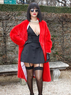 The look Rihanna wore to Dior's Fall/Winter Ready-to-Wear show in Paris is downright conservative compared to her after-party ensemble.