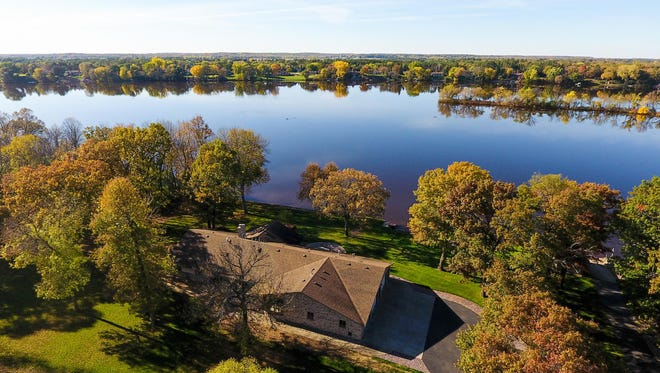 The home at 7095 Island View Road NW, Sauk Rapids, overlooks the Mississippi River.