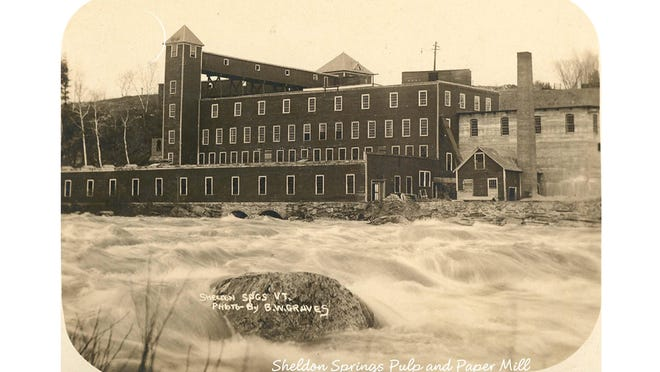 "The Missisquoi Pulp and Paper Mill in Sheldon Springs. Paper manufacturing began in 1914 with up to 250 men employed by the mill. As a result Sheldon Springs became known as a ""company town."""