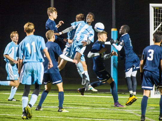 South Burlington and Burlington players go up for a corner kick in South Burlington on Wednesday, October 18, 2017.