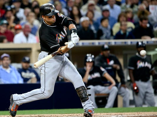 Miami Marlins' Martin Prado swings on a two-run home run against the San Diego Padres during the third of a baseball game Monday, June 13, 2016, in San Diego. The Marlins scored seven runs in the inning. (AP Photo/Lenny Ignelzi)