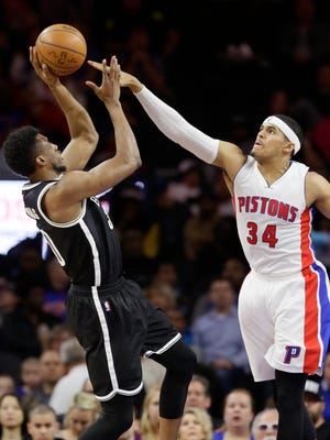 Brooklyn Nets forward Thaddeus Young shoots over Detroit Pistons forward Tobias Harris (34) during the second half of an NBA basketball game, Saturday, March 19, 2016, in Auburn Hills.
